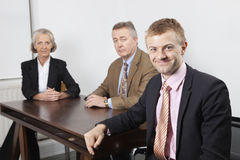 Portrait of confident business group at desk in office Stock Photography