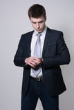Portrait of confident business man looking at his watch Royalty Free Stock Images