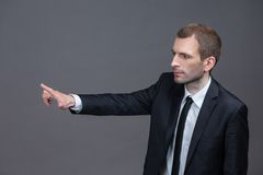 Portrait of confident business man pointing hand gestures Stock Images