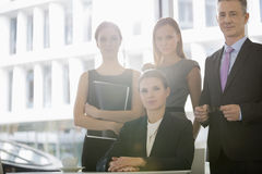 Portrait of confident business people in office cafeteria Stock Photos