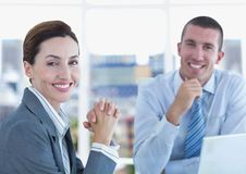 Portrait of confident business people smiling in office Stock Image