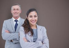 Portrait of confident business people standing arms crossed against brown background. Digital composite of Portrait of confident business people standing arms Stock Image