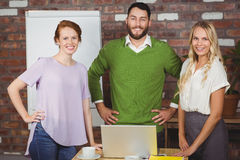 Portrait of confident business people standing in office Stock Image