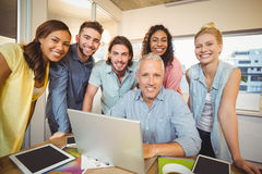 Portrait of confident business people with technologies Royalty Free Stock Photos