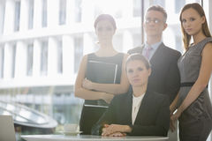 Portrait of confident business team in office cafeteria Royalty Free Stock Images