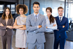 Portrait of confident business team in office. Portrait of confident business team standing in office with their hands crossed stock image