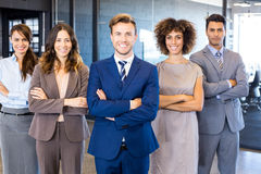 Portrait of confident business team in office. Portrait of confident business team standing in office with their hands crossed Royalty Free Stock Photo