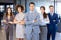 Portrait of confident business team in office. Portrait of confident business team standing in office with their hands crossed Stock Photos