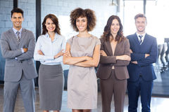 Portrait of confident business team in office. Portrait of confident business team standing in office with their hands crossed Stock Photography