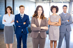 Portrait of confident business team in office. Portrait of confident business team standing in office with their hands crossed Stock Images