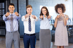 Portrait of confident business team pointing in office Royalty Free Stock Photography