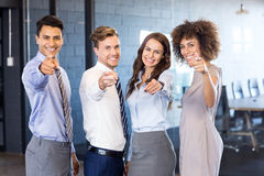 Portrait of confident business team pointing in office Stock Photography