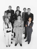 Portrait of confident business team standing with arms crossed against white background Stock Images