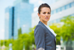 Portrait of confident business woman in modern office district. Into the ultra-modern business trends. Portrait of confident business woman in modern office Royalty Free Stock Photo