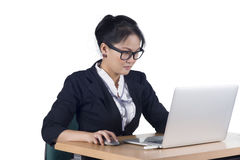 Portrait of confident business woman sitting at the table and wo Stock Images