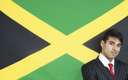 Portrait of a confident businessman against Jamaican flag Royalty Free Stock Photography