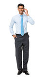 Portrait Of Confident Businessman Answering Smart Phone Royalty Free Stock Photos