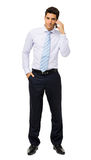 Portrait Of Confident Businessman Answering Smart Phone Royalty Free Stock Image