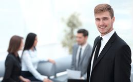 Portrait of confident businessman on background of office. Photo with copy space stock photos