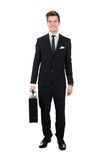 Portrait of confident businessman carrying briefcase Stock Photography