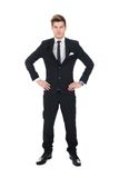 Portrait of confident businessman with hands on hips Stock Image