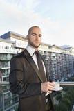Portrait of confident businessman having cup of tea Stock Photo