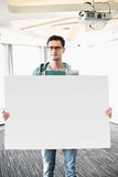 Portrait of confident businessman holding blank board in creative office Royalty Free Stock Photos