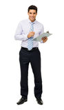 Portrait Of Confident Businessman Holding Clipboard And Pen Royalty Free Stock Image