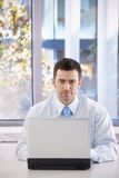 Portrait of confident businessman with laptop Royalty Free Stock Images