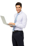 Portrait Of Confident Businessman With Laptop Stock Photography