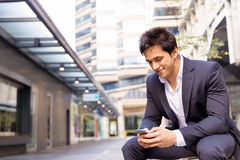 Portrait of confident businessman with mobile phone outdoors Stock Photography