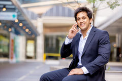 Portrait of confident businessman with mobile phone outdoors Stock Images