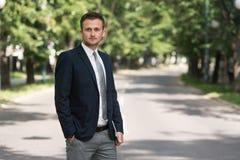 Portrait Of A Confident Businessman Outdoors In Park Stock Image
