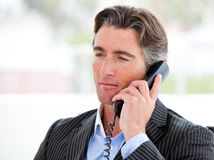 Portrait of a confident businessman on phone Royalty Free Stock Photos