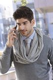 Portrait of confident businessman on phone call. Portrait of confident young businessman talking on mobilephone, smiling Royalty Free Stock Photos