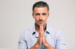 Portrait of a confident businessman praying Royalty Free Stock Image