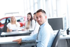 Portrait of confident businessman sitting at the Desk Royalty Free Stock Photography