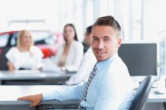 Portrait of confident businessman sitting at the Desk Royalty Free Stock Photo