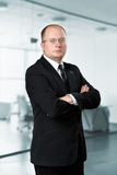 Portrait of a confident businessman standing with arms crossed Royalty Free Stock Image