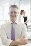 Portrait of confident businessman standing arms crossed in office Royalty Free Stock Photography
