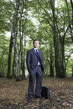 Portrait Of Confident Businessman Standing In Forest Stock Photos