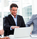Portrait of a confident businessman using a laptop Stock Photography
