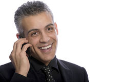 Portrait of confident businessman using mobile phone Royalty Free Stock Photography