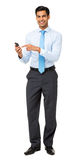 Portrait Of Confident Businessman Using Smart Phone Stock Photography