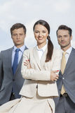 Portrait of confident businesspeople standing together against sky Royalty Free Stock Photography