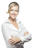 Portrait of confident businesswoman, folded arms. Beauty shot of confident, smiling, blonde Caucasian business woman folding arms and looking into camera Stock Photo