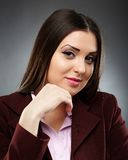 Portrait of a confident businesswoman with hand on chin Stock Images