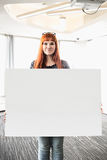 Portrait of confident businesswoman holding blank placard in creative office Royalty Free Stock Images