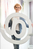 Portrait of confident businesswoman holding at sign in creative office Royalty Free Stock Photography