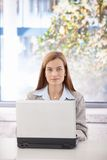 Portrait of confident businesswoman with laptop Stock Images